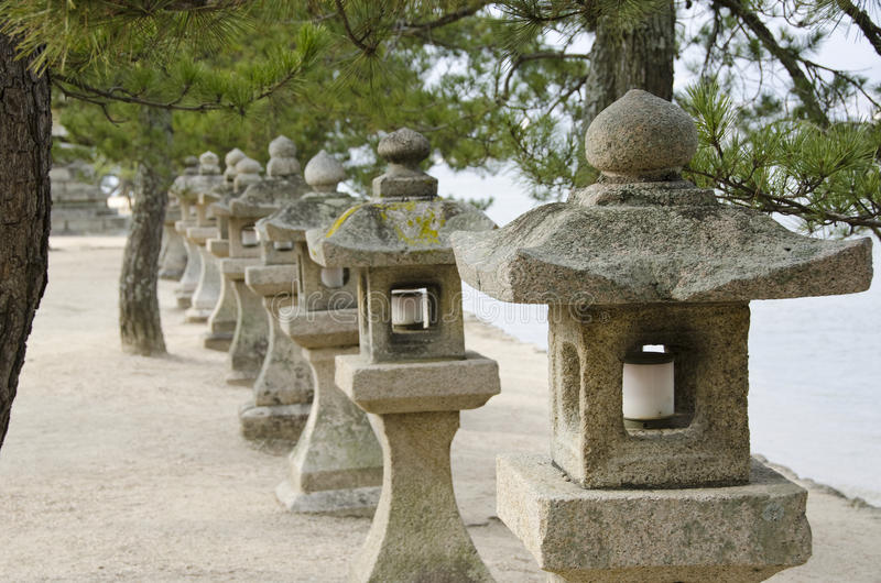 Row of stone lanterns in Japan stock photography