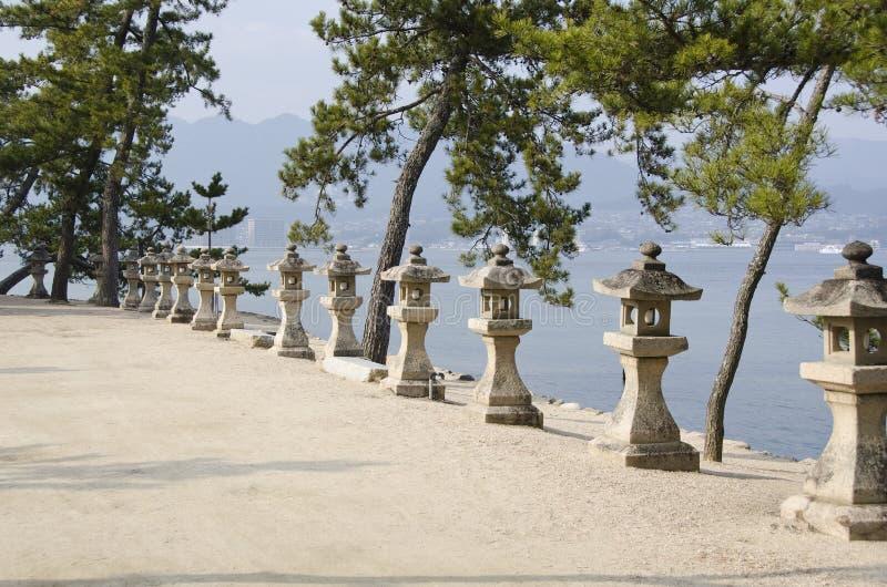 Row of stone lanterns in Japan stock photo