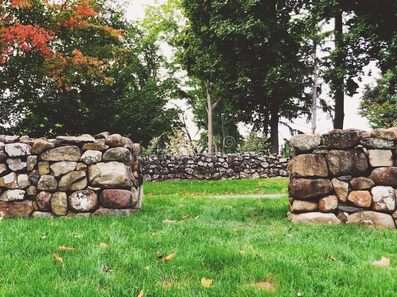 A row of stone wall inside Sunken Garden at Hill–Stead Museum. In Farmington, Connecticut, United States stock photos