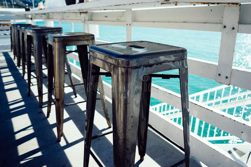 Row of stool by water stock images