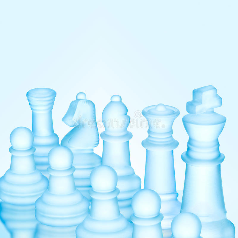 In a row. Strategy and tactics concept; icy frosted chess figures standing in a row ready for game stock image