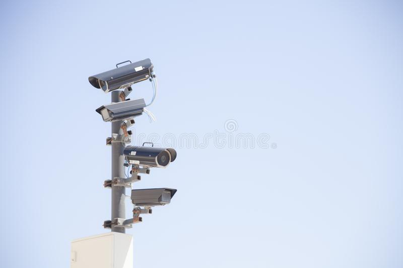 Surveillance cams row day royalty free stock image