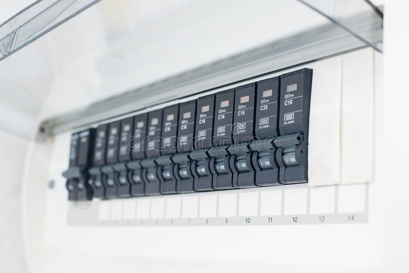 A row of switched off household electrical circuit breakers on a wall panel.  royalty free stock image