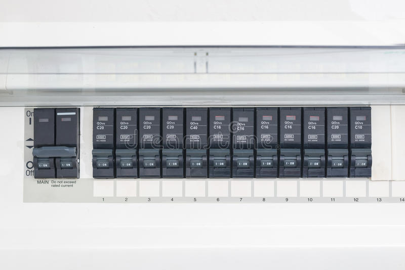 A row of switched off household electrical circuit breakers on a wall panel.  royalty free stock photo