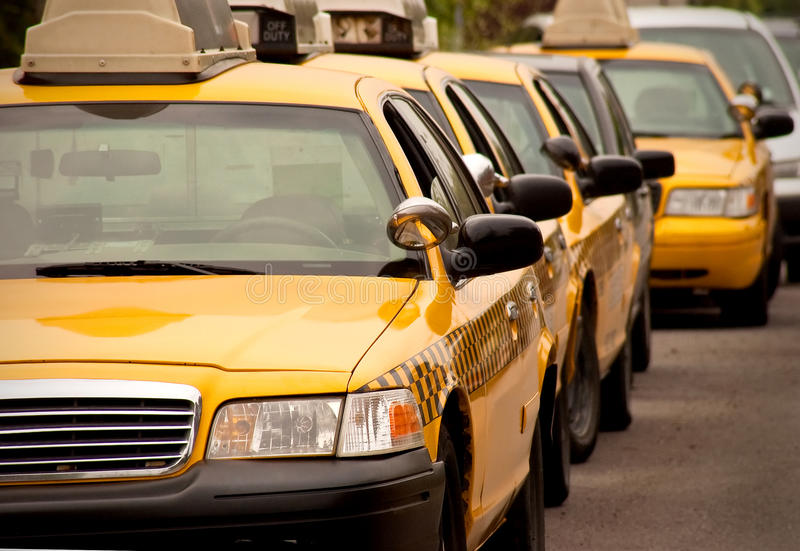 Row of taxi cabs. A row of taxi cabs at a stand royalty free stock photography