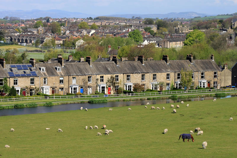Row of terraced stone houses by canal, Lancaster stock photos