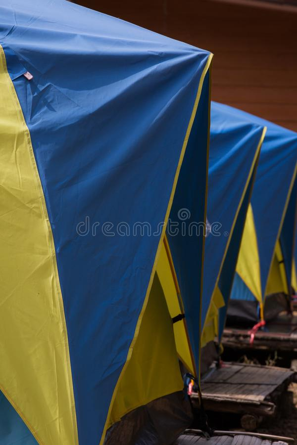 Three blue and yellow tents in a row royalty free stock images