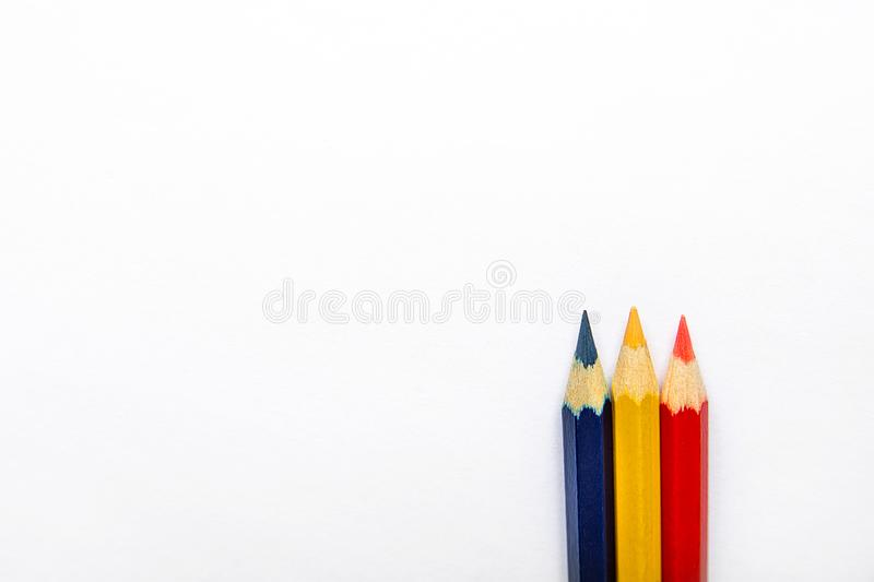 Row of Three Multicolored Pencils Red Yellow Blue in Bottom and Top on White Paper Background. Business Creativity Graphic Design stock photo