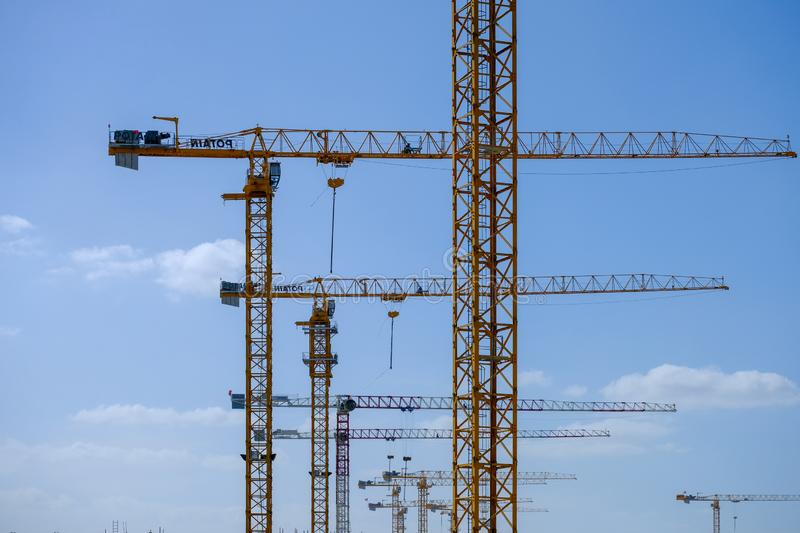 Row of tower crains at construction site. Architecture constructing equipment crane cranes development engineering high hook industrial industry lift lifting stock images