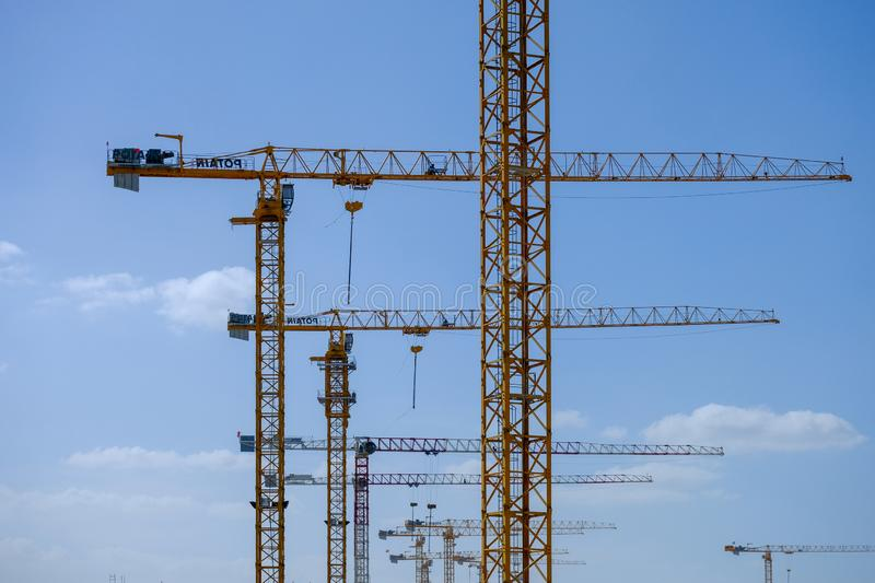 Row of tower crains at construction site. Architecture constructing equipment crane cranes development engineering high hook industrial industry lift lifting royalty free stock image