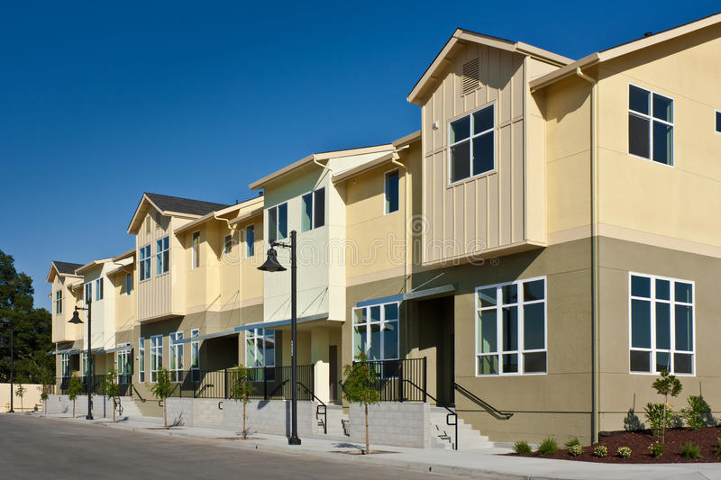 Row of Townhomes. A row of new townhomes / condominiums stock photo