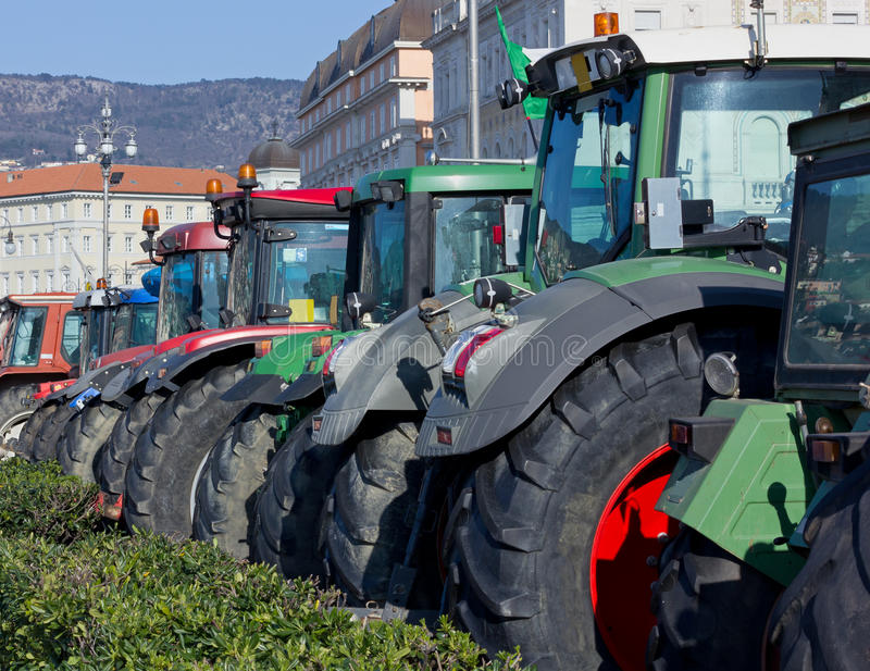 Row of Tractors Parked on Trieste's Waterfront. Italy royalty free stock images