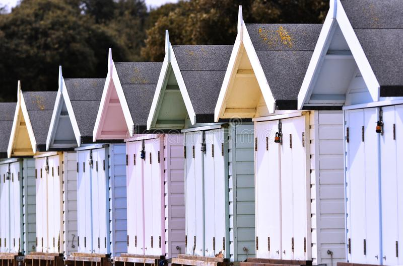 Beach huts in a row royalty free stock photos