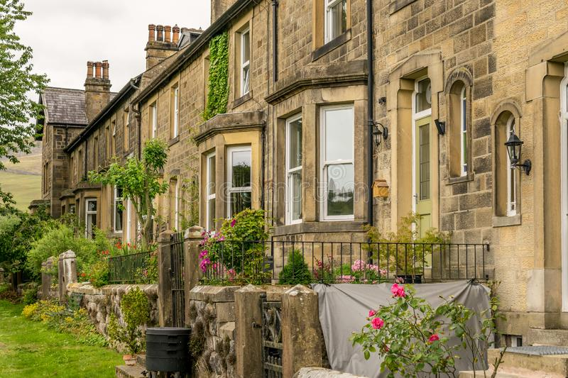 A row of traditional terraced houses with gardens stock photos