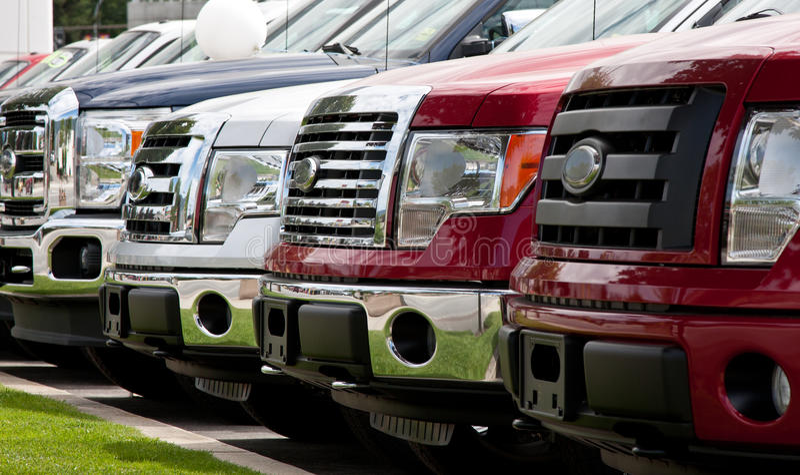 Row of trucks stock photos