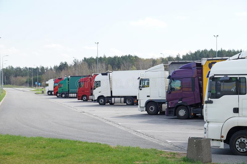 A row of trucks in the rest area royalty free stock photo