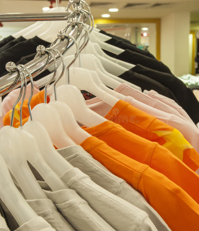 Row of tshirts hanging on a rail