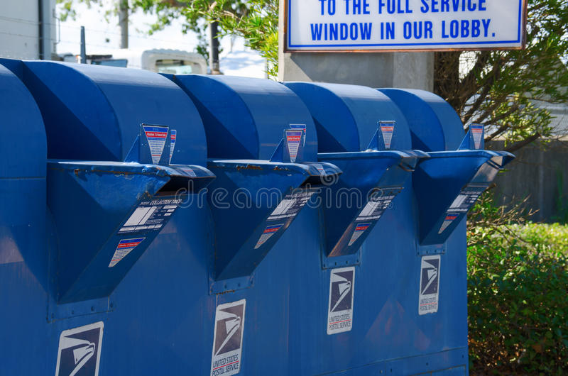 Row of United States Postal Service mailboxes stock photo