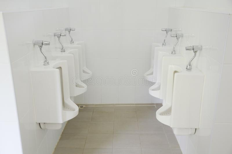 Row of urinals stock photo