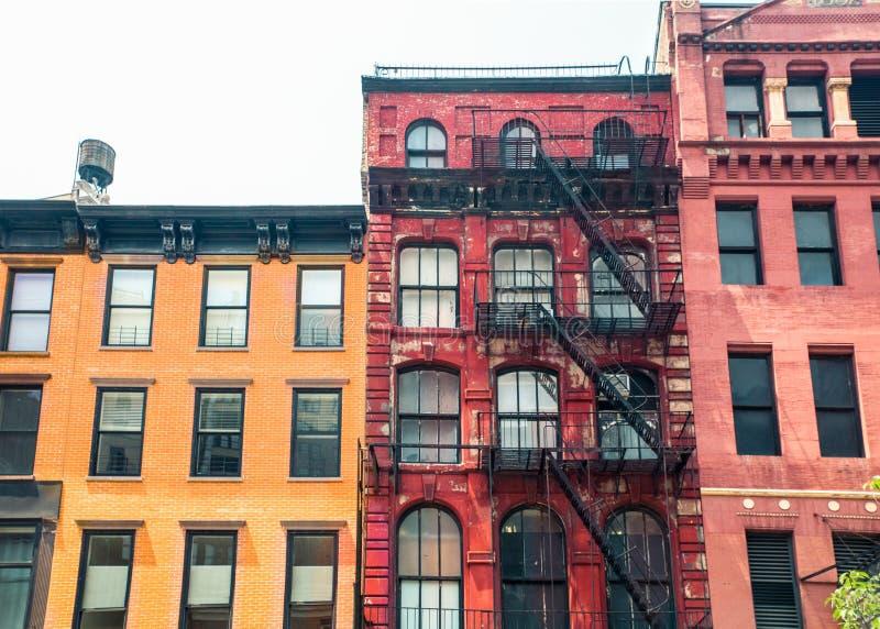 Row of vintage New York City apartment building facades stock photos