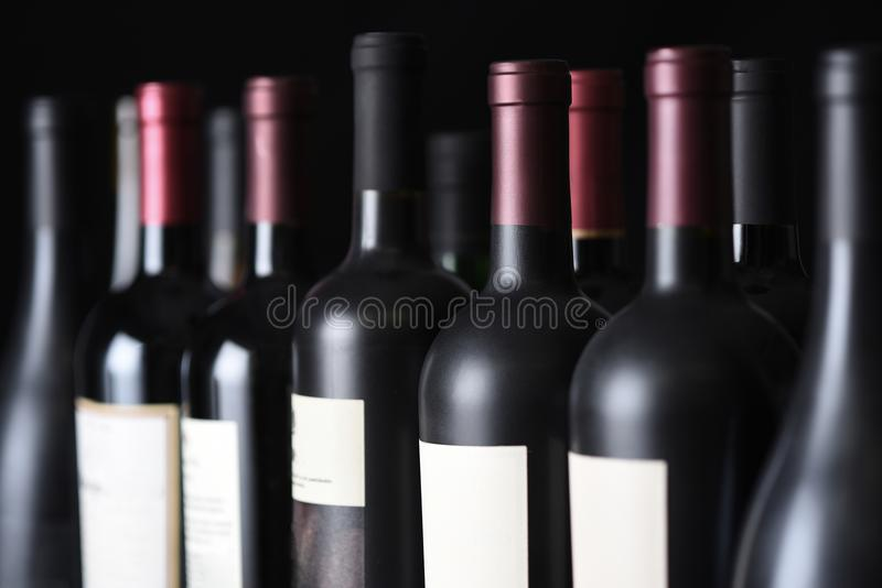 Row of vintage wine bottles royalty free stock photography