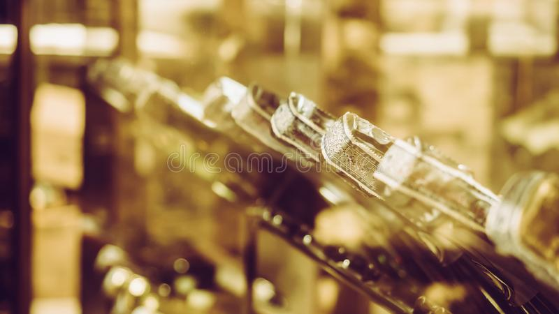 Row of vintage wine bottles in a wine cellar royalty free stock photos