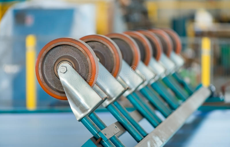 Row of wheels, industrial spinning wheel. stock photos