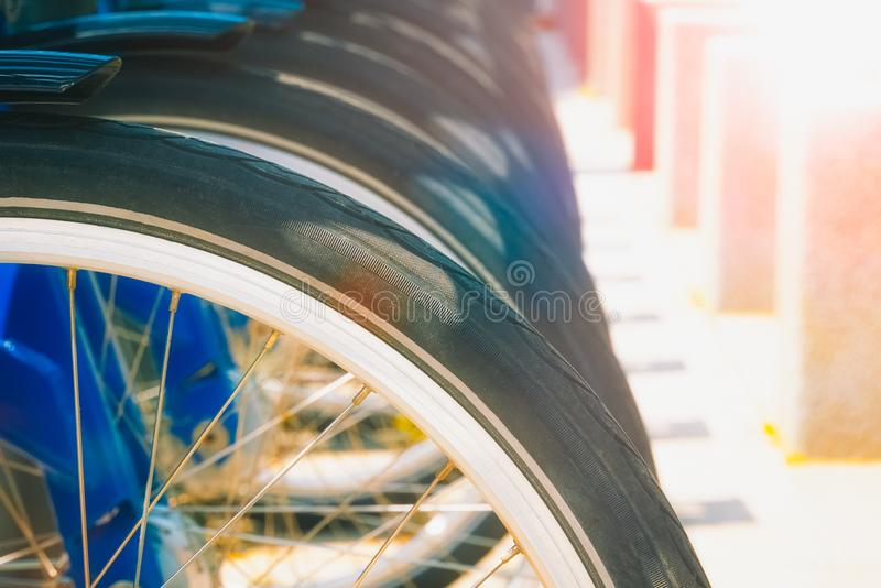 Row of wheels of parked bicycles stock photography