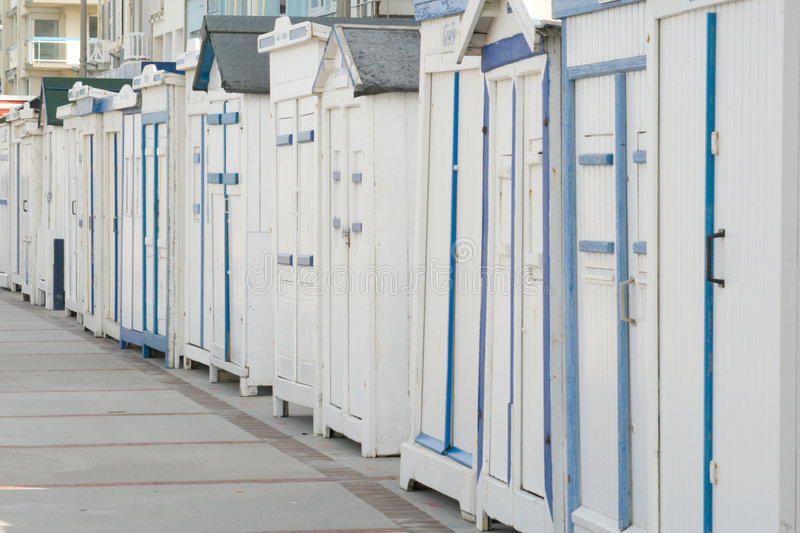 Row of white beach chalets. Or cabins receding into distance stock photo