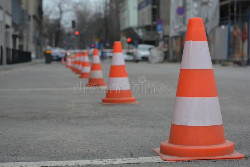 Row of white and orange traffic cones royalty free stock photography