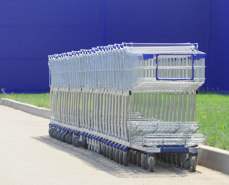 Row of white shopping carts royalty free stock photo