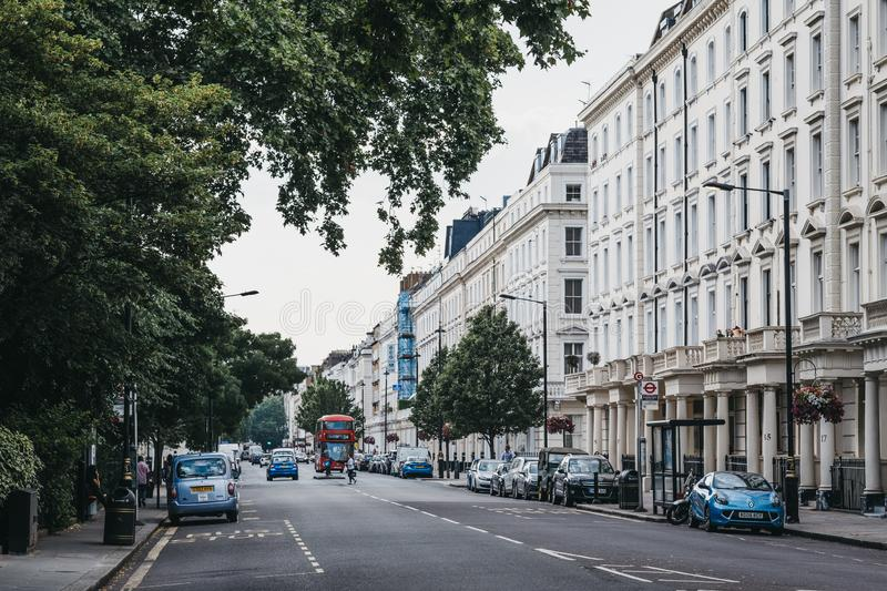 Row of white terraced houses on a street in Pimlico, London, UK. London, UK - July 16, 2019: Row of white terraced houses on a street in Pimlico, an upscale stock photography