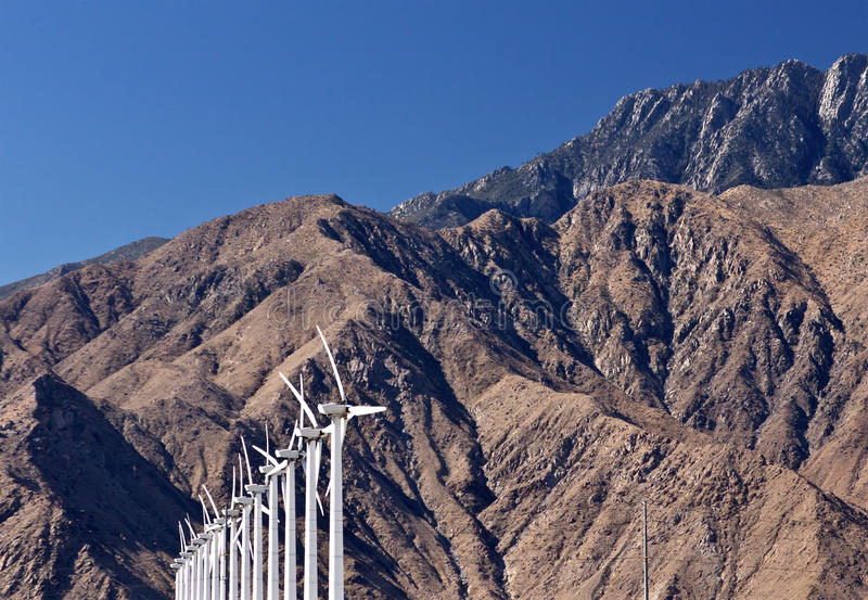 Download Row Of White Wind Turbines At Mountains Royalty Free Stock Photo - Image: 26518655