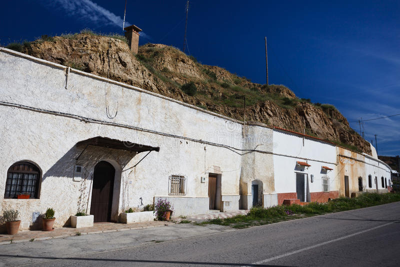Row of whitewashed hillside cave houses in Gaudix royalty free stock image