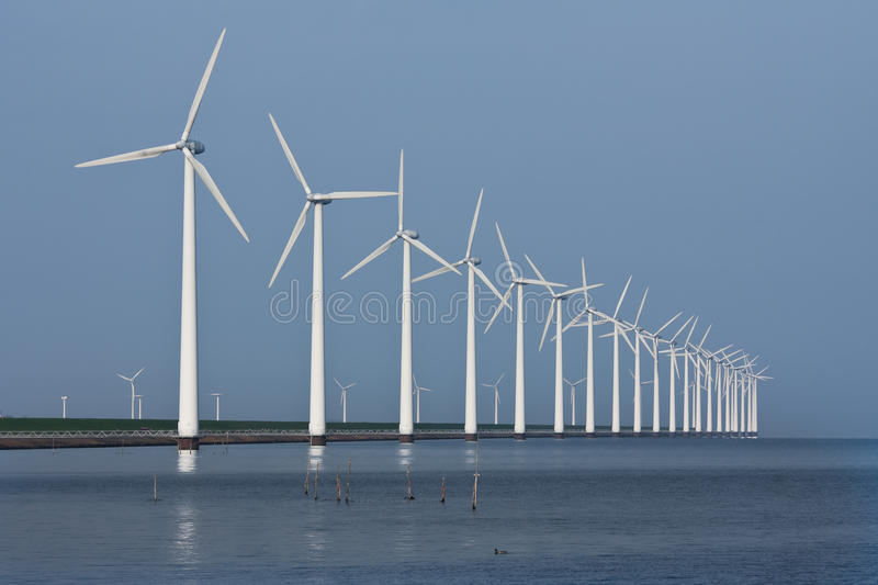 Download Row Of Windmills, Mirrored In The Dutch Sea Stock Image - Image of line, endless: 18662067