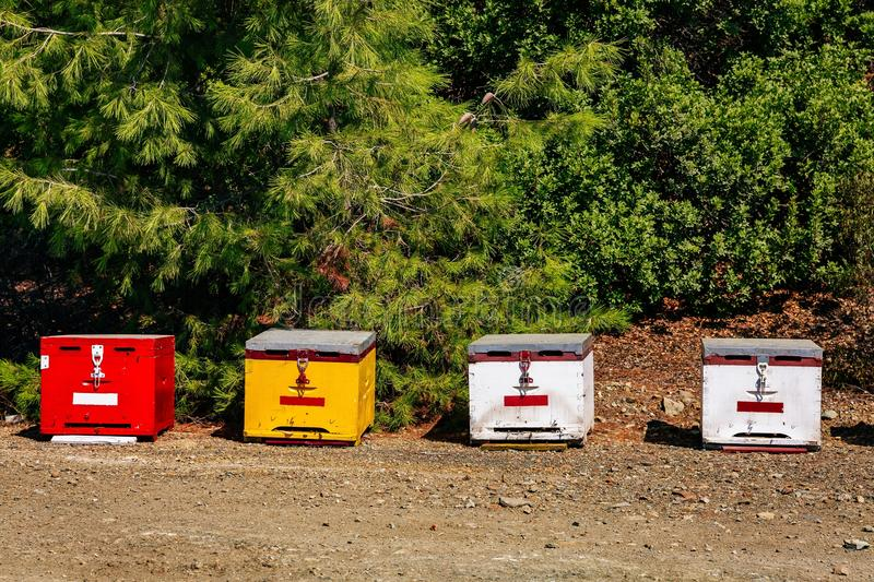 A row of wooden colorful bee hives in summertime. In Greece stock images