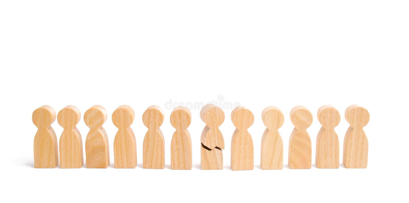 A row of wooden people and a broken figure of a person among them. The concept of a weak link. Did not give up to expectations. And did not fulfill the task stock photography