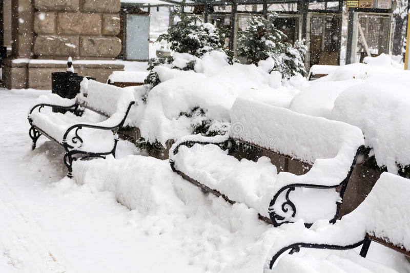 Download Row Of  Wooden Snow Covered Benches In Winter Sofia Stock Photo - Image: 83720332