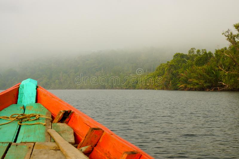 Rowboat in early morning mist stock images
