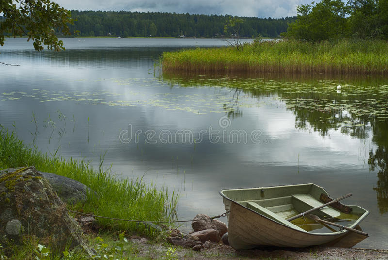Rowboat at shore stock photo
