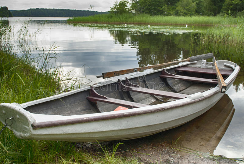 Download Rowboat at shore stock image. Image of white, tranquility - 30411075