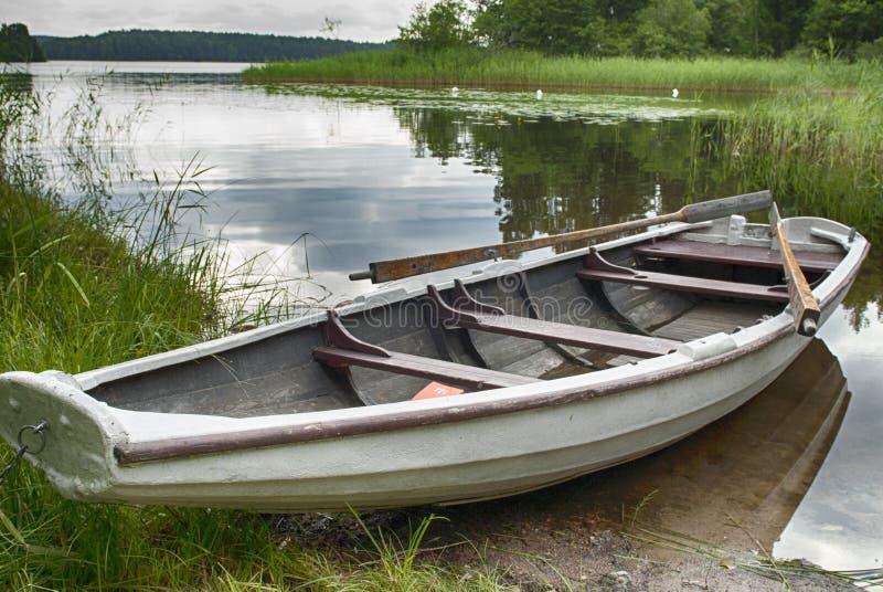 Rowboat at shore royalty free stock photo