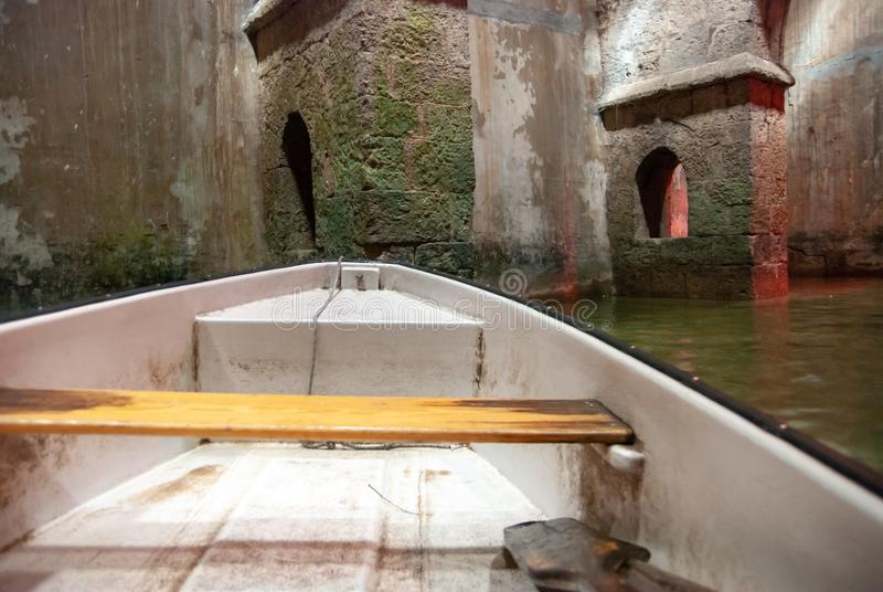 Rowboat at the underground Pool of Arches in Ramla. Israel. Pool built during the reign of the caliph Haroun al-Rashid in 789 AD stock photos