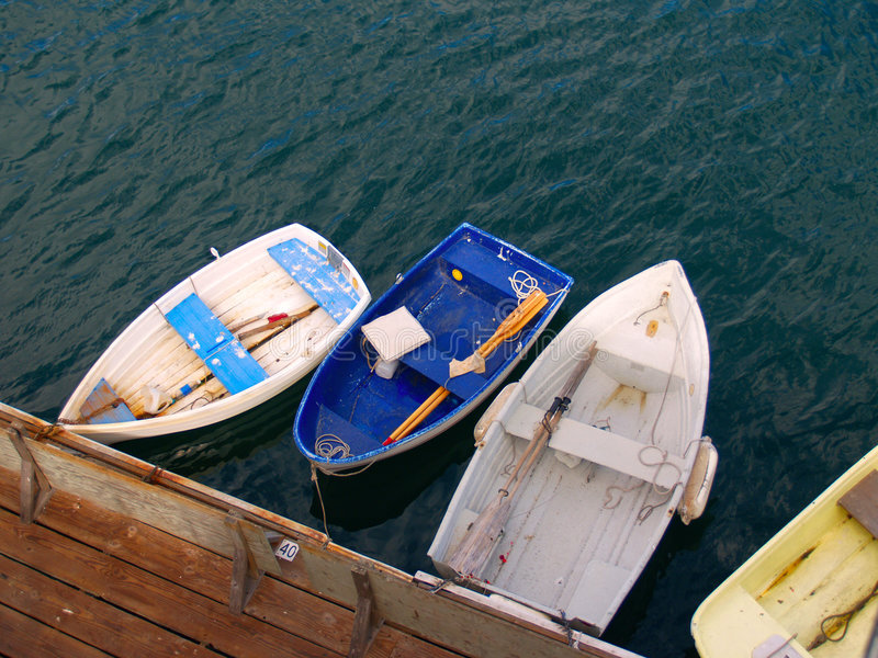 Rowboats. Tied to a pier, waiting for occupants stock image