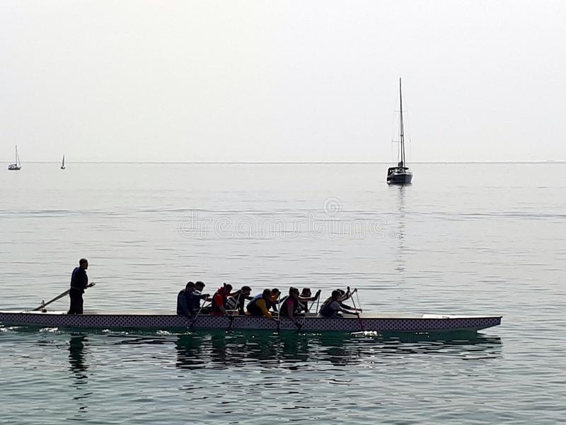 Rowers on the calm sea stock photography