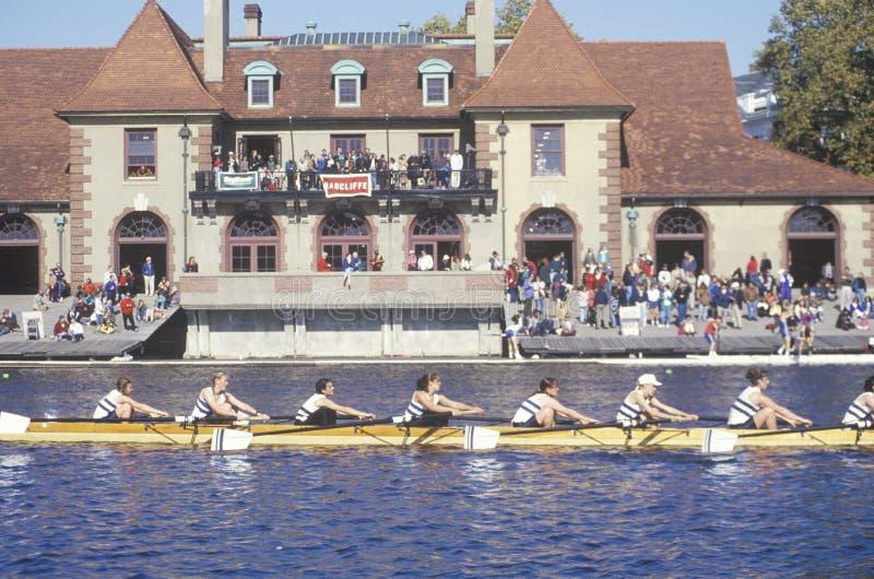 Rowers passing Ratcliff Boat House, Charles Regatta, Cambridge, Massachusetts stock photography