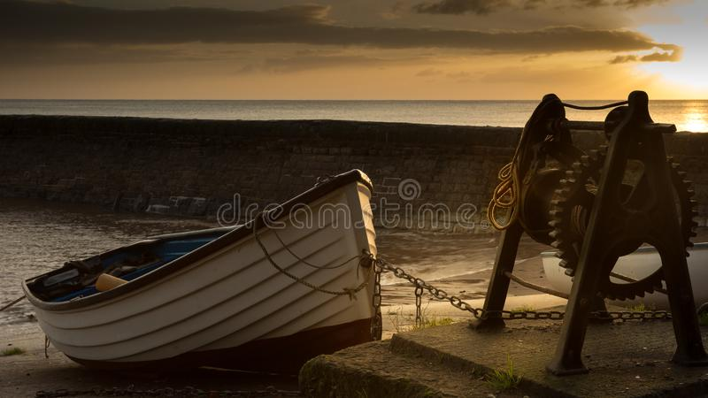 Rowing boat at sunrise royalty free stock images