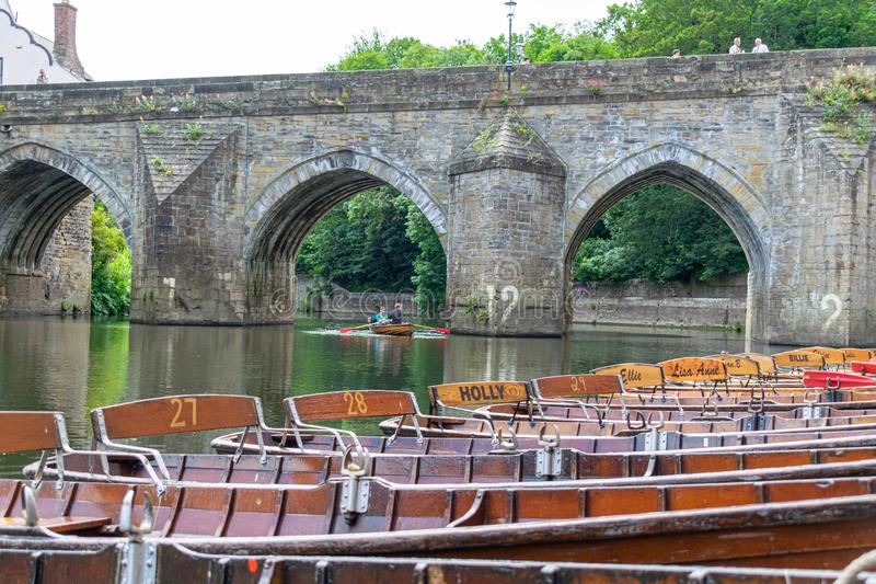 Rowing boats lined up on the Wear river in the city centre of Durham stock photos