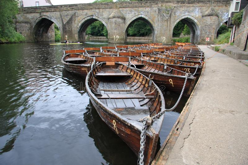 Rowing Boats on the River Wear at Elvet Bridge in Durham royalty free stock photo