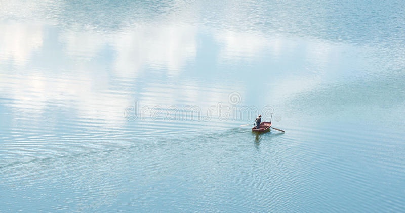 Rowing cross a blue river in wetland royalty free stock image